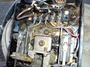 internals of LWCO electrical box damaged by chemical intrusion via failed chem injection line